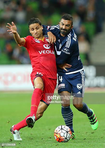 Marcelo Carrusca of United and Fahid Ben Khalfallah of the Victory competes for the ball during the round 20 ALeague match between Melbourne Victory...