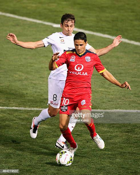 Marcelo Carrusca of United competes for the ball with Mateo Poliak of the Wanderers during the round 18 ALeague match between Adelaide United and...