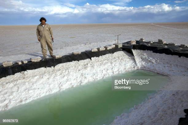 Marcelo Castro the lead engineer for the Bolivian government's pilot plant for lithium production inspects an evaporating pool designed to isloate...