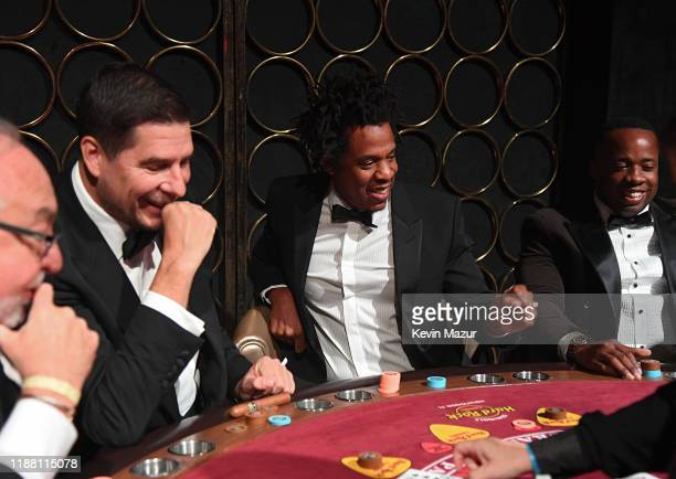 Marcelo Claure JAYZ and Yo Gotti attend the Shawn Carter Foundation Gala at Hard Rock Live in the Seminole Hard Rock Hotel Casino on November 16 2019...
