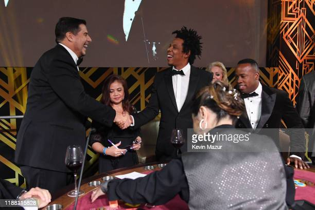 Marcelo Claure, JAY-Z and Yo Gotti attend the Shawn Carter Foundation Gala at Hard Rock Live! in the Seminole Hard Rock Hotel & Casino on November...