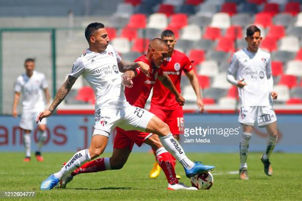 Marcelo Correa of Atlas fights for the ball with Jonathan Maidana of Toluca during the 10th round match between Toluca and Atlas as part of the...