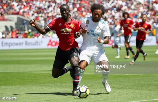 Marcelo Da Silva Junior of Real Madrid and Eric Bailly of Manchester United go for the ball during the International Champions Cup match at Levi's...