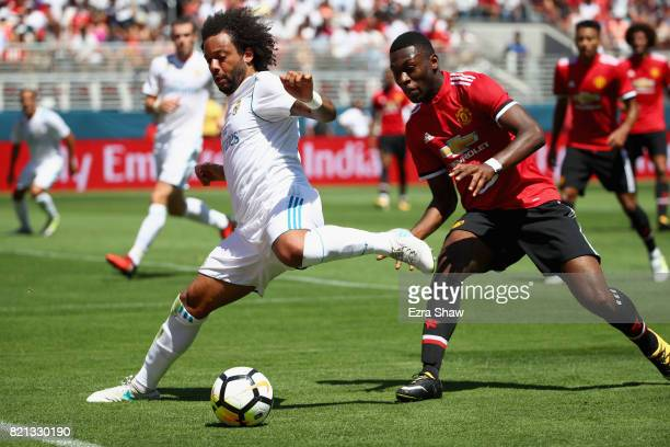 Marcelo Da Silva Junior of Real Madrid and Timothy FosuMensah of Manchester United go for the ball during the International Champions Cup match at...