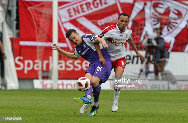 Marcelo De Freitas Costa of Cottbus challenges for the ball with Thomas Konrad of Osnabrueck during the 3. Liga match between FC Energie Cottbus and...