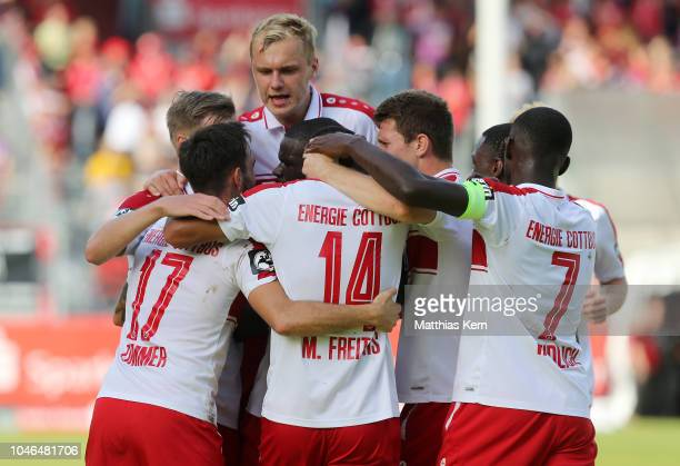 Marcelo De Freitas Costa of Cottbus jubilates with team mates after scoring the second goal during the 3. Liga match between FC Energie Cottbus and...