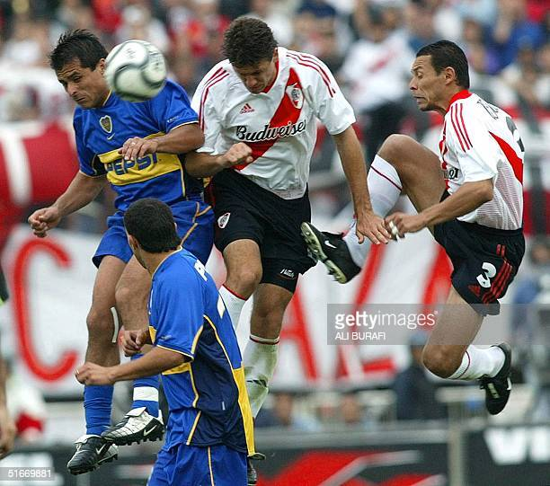 Marcelo Delgado player of Boca Junior Martin Demichelis player of River Plate Ricardo Rojas player of River Plate and Carlos Tevez fight for the ball...