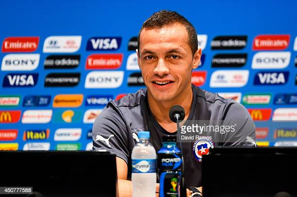 Marcelo Diaz of Chile faces the media during the Chile press conference ahead of their 2014 FIFA World Cup Group B match against Chile at Maracana on...