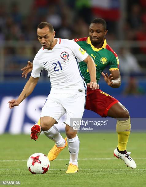 Marcelo Diaz of Chile is put under pressure from Sebastien Siani of Cameroon during the FIFA Confederations Cup Russia 2017 Group B match between...
