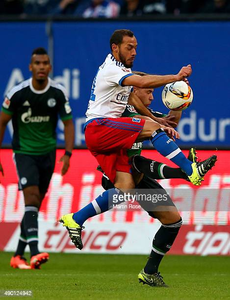 Marcelo Diaz of Hamburg and Max Meyer of Schalke battle for the ball during the Bundesliga match between Hamburger SV and FC Schalke 04 at...