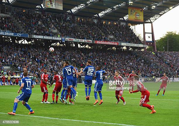Marcelo Diaz of Hamburger SV scores their first and equalising goal from a freekick during the Bundesliga playoff second leg match between Karlsruher...
