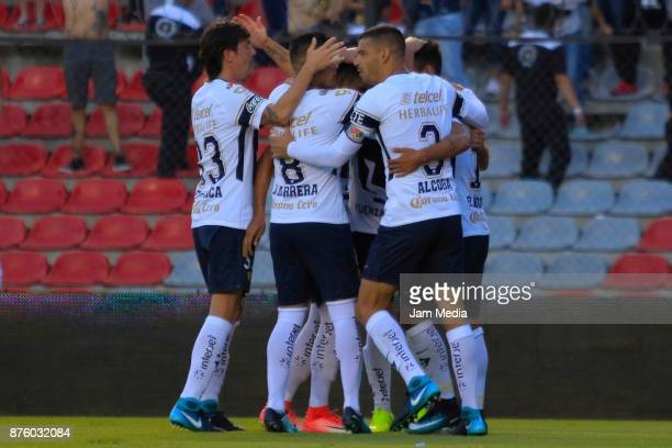 Marcelo Diaz of Pumas celebrates with teammates after scoring the first goal of his team during the 17th round match between Queretaro and Pumas UNAM...
