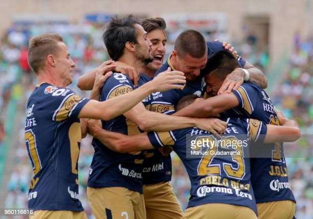 Marcelo Diaz of Pumas celebrates with teammates after scoring the first goal of his team during the 16th round match between Santos Laguna and Pumas...