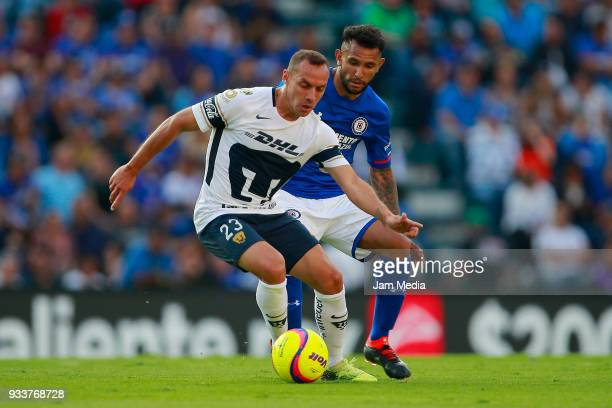 Marcelo Diaz of Pumas fights for the ball with Walter Montoya of Cruz Azul during the 12th round match between Cruz Azul and Pumas UNAM as part of...