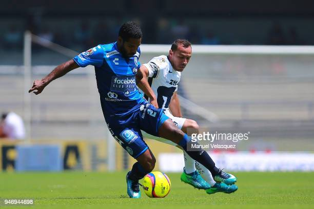 Marcelo Diaz of Pumas struggles for the ball against Brayan Angulo of Puebla during the 15th round match between Pumas UNAM and Puebla as part of the...