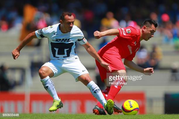 Marcelo Diaz of Pumas struggles for the ball with Antonio Rios of Toluca during the 11th round match between Pumas UNAM and Toluca as part of the...