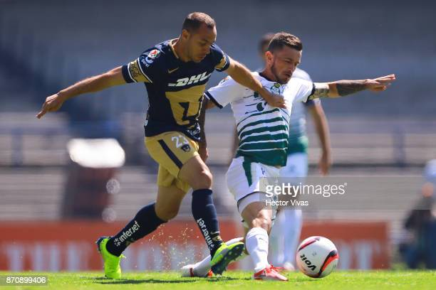 Marcelo Diaz of Pumas struggles for the ball with Brian Lozano of Santos Laguna during the 16th round match between Pumas UNAM and Santos Laguna as...