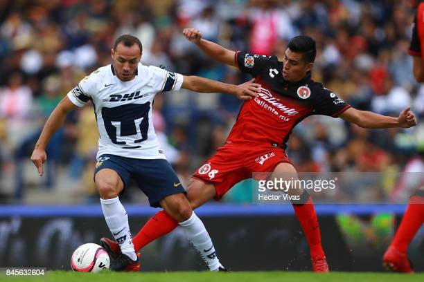 Marcelo Diaz of Pumas struggles for the ball with Joe Corona of Tijuana during the 8th round match between Pumas UNAM and Tijuana as part of the...