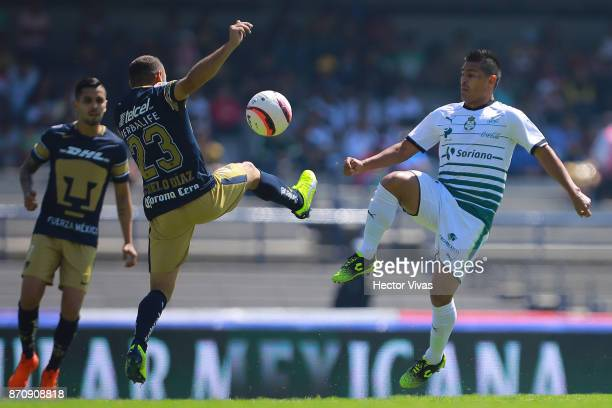 Marcelo Diaz of Pumas struggles for the ball with Osvaldo Martinez of Santos Laguna during the 16th round match between Pumas UNAM and Santos Laguna...
