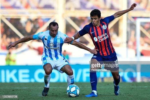 Marcelo Diaz of Racing Club fights for the ball with Oscar Romero of San Lorenzo during a match between San Lorenzo and Racing Club as part of...