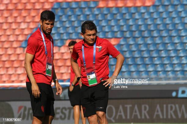 Marcelo Estigarribia and Luis Miguel Rodriguez of Colon talk during the field scouting at La Nueva Olla Stadium on November 8, 2019 in Asuncion,...
