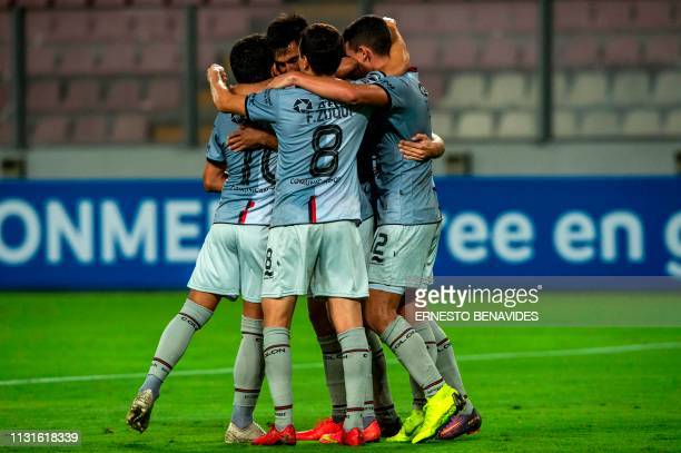 Marcelo Estigarribia of Argentina's Colon de Santa Fe celebrates with teammates after scoring against Peru's Deportivo Municipal during a...