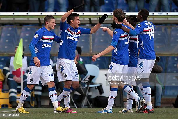Marcelo Estigarribia of UC Sampdoria celebrates with teammates after scoring a goal during the Serie A match between UC Sampdoria and AS Roma at...
