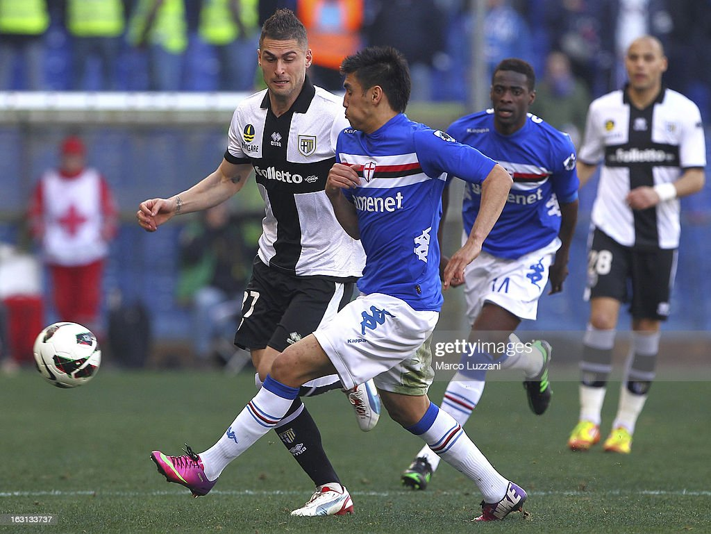 Marcelo Estigarribia (R) of UC Sampdoria competes for the ball with Aleandro Rosi (L) of Parma FC during the Serie A match between UC Sampdoria and Parma FC at Stadio Luigi Ferraris on March 3, 2013 in Genoa, Italy.
