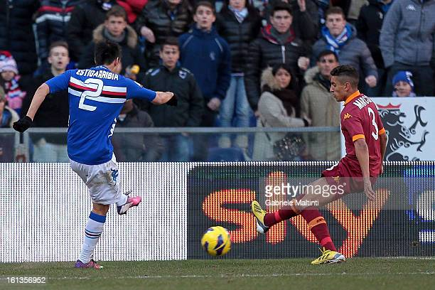 Marcelo Estigarribia of UC Sampdoria scores the opening goal past Marquinhos of AS Roma during the Serie A match between UC Sampdoria and AS Roma at...