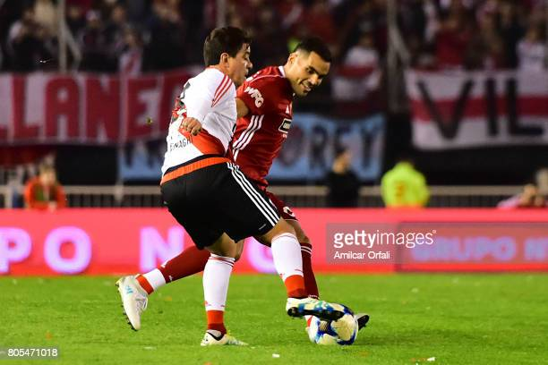 Marcelo Gallardo and Gabriel Mercado fight for the ball during Fernando Cavenaghi's farewell match at Monumental Stadium on July 01 2017 in Buenos...