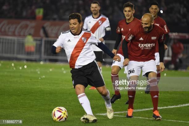 Marcelo Gallardo and Javier Pinola fight for the ball during the farewell match of Uruguayan player Rodrigo Mora at Estadio Monumental Antonio...