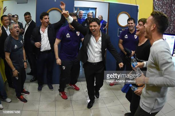 Marcelo Gallardo coach of River Plate celebrates in the dressing room with his team after a match between Boca Juniors and River Plate as part of...