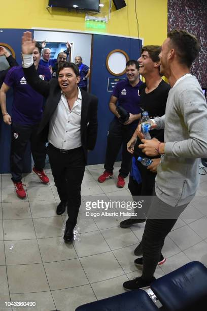 Marcelo Gallardo coach of River Plate celebrates with the players in the visitor's dressing room after a match between Boca Juniors and River Plate...