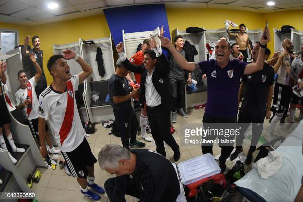 Marcelo Gallardo coach of River Plate celebrates with the players in the visitor's dressing room later a match between Boca Juniors and River Plate...