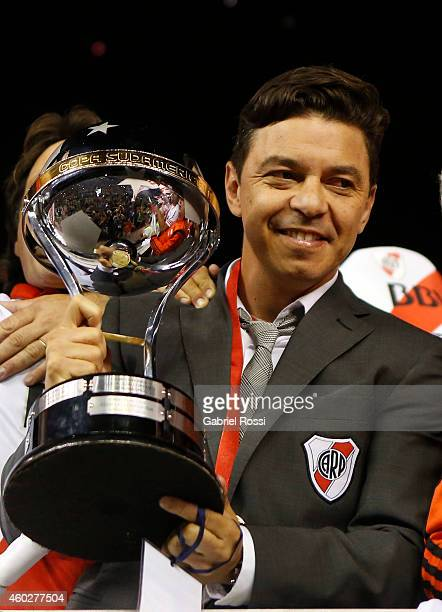 Marcelo Gallardo coach of River Plate celebrates with the trophy after winning the second leg final match between River Plate and Atletico Nacional...