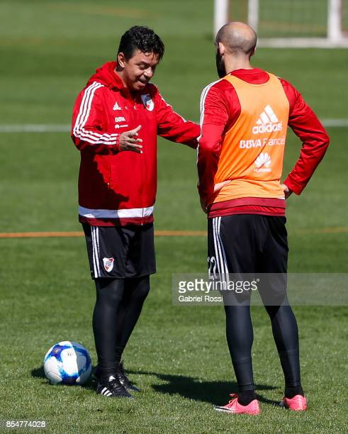 Marcelo Gallardo coach of River Plate gives instructions to Javier Pinola of River Plate during a training session at River Plate's training camp on...