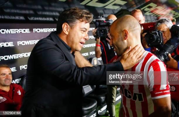 Marcelo Gallardo coach of River Plate greets Javier Mascherano of Estudiantes before a match between Estudiantes and River Plate as part of Superliga...