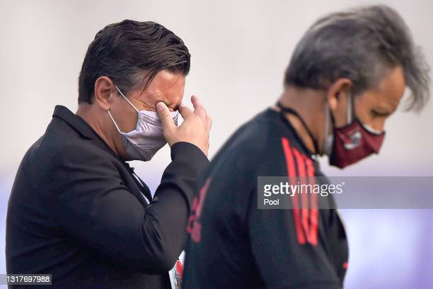 Marcelo Gallardo coach of River Plate reacts to tear gas thrown by riot police during a protest outside the stadium before a match between Junior and...