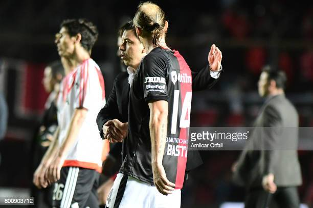 Marcelo Gallardo coach of River Plate shakes hands with Adrian Bastia of Colon after a match between Colon and River Plate as part of Torneo Primera...