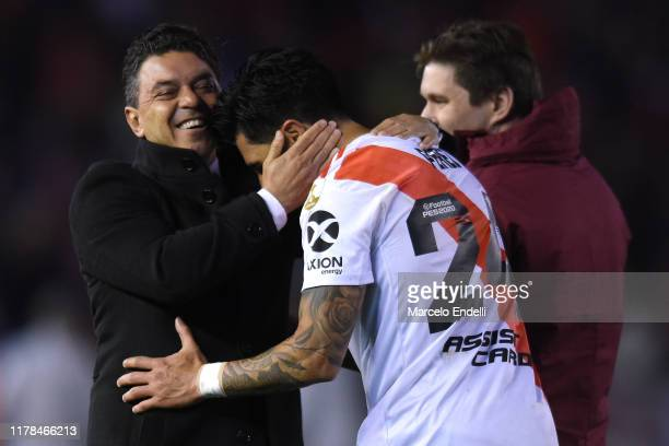 Marcelo Gallardo head coach of River Plate celebrates with Enzo Perez of River Plate after winning during the semi final first leg match between...