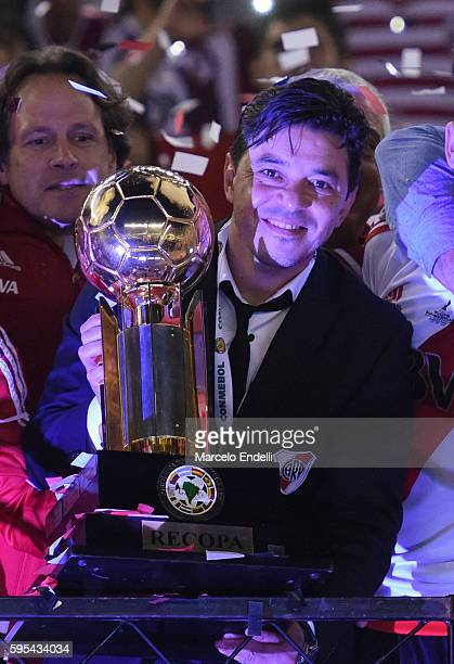 Marcelo Gallardo head coach of River Plate celebrates with the trophy after winning the Recopa Sudamericana 2016 during a second leg match between...
