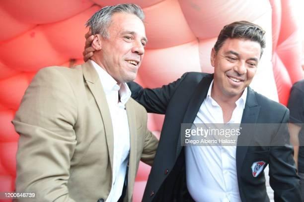 Marcelo Gallardo head coach of River Plate greets Lucas Pusineri head coach of Independiente prior a match between Independiente and River Plate as...
