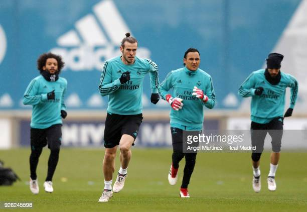 Marcelo Gareth Bale Keylor Navas and Karim Benzema of Real Madrid warm up during a training session at Valdebebas training ground on March 2 2018 in...