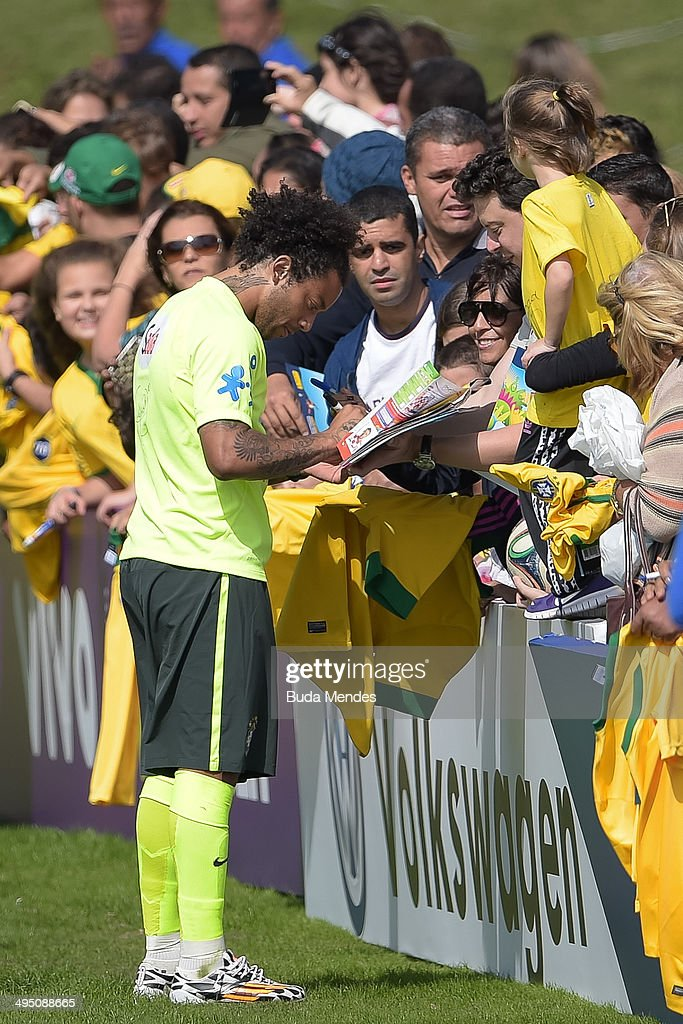 d51090b8e Marcelo gives autographs after a training session of the Brazilian ...
