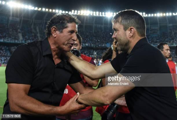 Marcelo Gomez coach of Godoy Cruz greets Eduardo Coudet coach of Racing Club before a match between Racing Club and Godoy Cruz at Juan Domingo Peron...