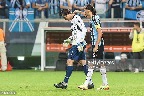 Marcelo Grohe and Hernan Barcos of Gremio leave the field after loose the match between Gremio v San Lorenzo as part of round of sixteen of Copa...