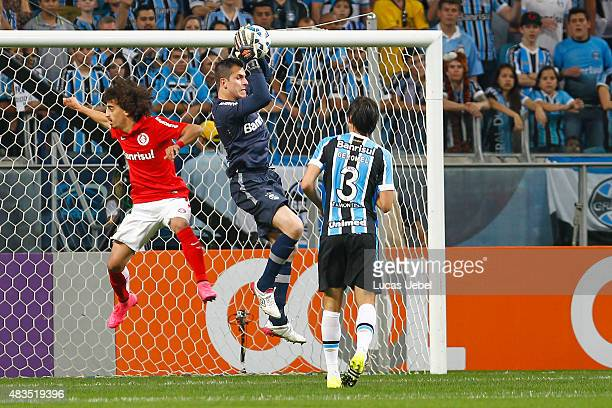 Marcelo Grohe of Gremio battles for the ball against Valdivia of Internacional during the match Gremio v Internaciona as part of Brasileirao Series A...