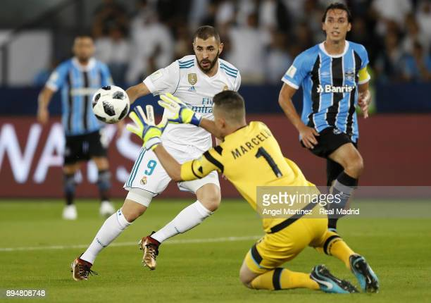 Marcelo Grohe of Gremio saves a ball from Karim Benzema of Real Madrid during the FIFA Club World Cup UAE 2017 Final match between Real Madrid CF and...