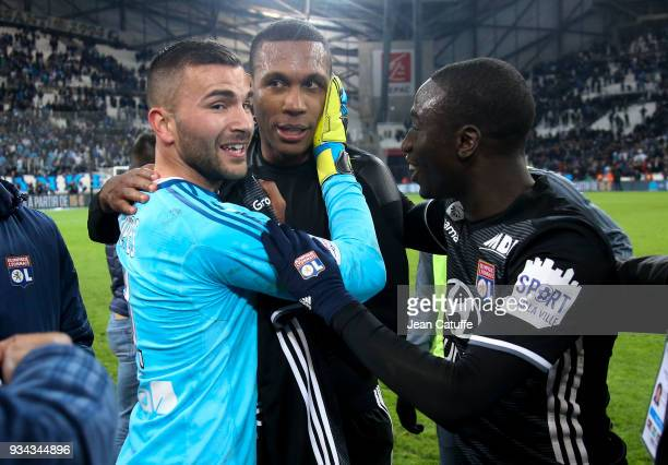 Marcelo Guedes of Lyon surrounded by goalkeeper Anthony Lopes and Ferland Mendy during the chaos following the French Ligue 1 match between Olympique...