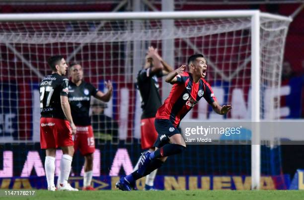 Marcelo Herrera of San Lorenzo celebrates after scoring the first goal of his team during a round of sixteen second leg match between San Lorenzo and...